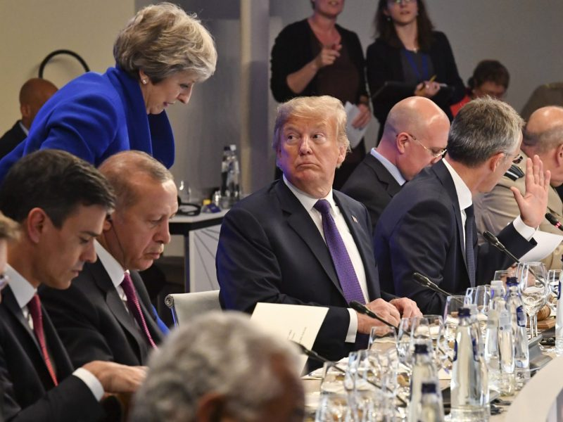US President Donald Trump looks at British Prime Minister Theresa May during a dinner in Brussels on July 11, 2018. NATO leaders gathered in Brussels on July 11 for a two-day summit. Photo: AFP/Geert Vanden Wijngaert