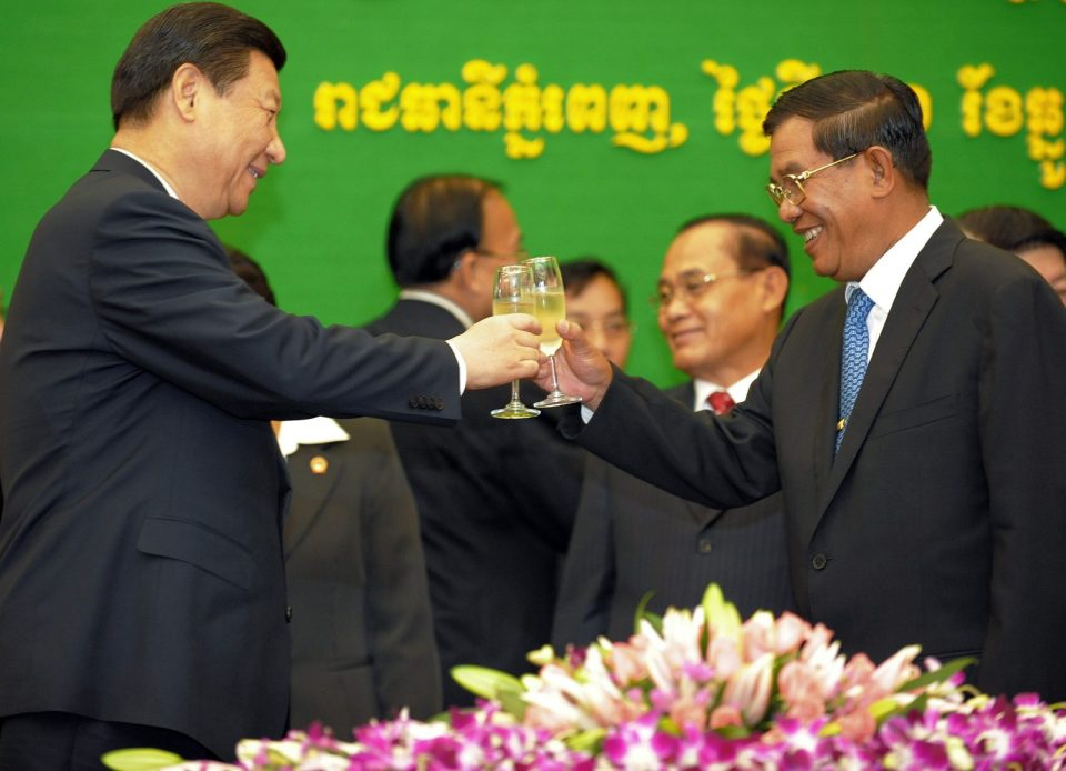 Best of friends: Xi Jinping (L) Cambodian Prime Minister Hun Sen in Phnom Penh on December 21, 2009. Photo: AFP/Tang Chhin Sothy