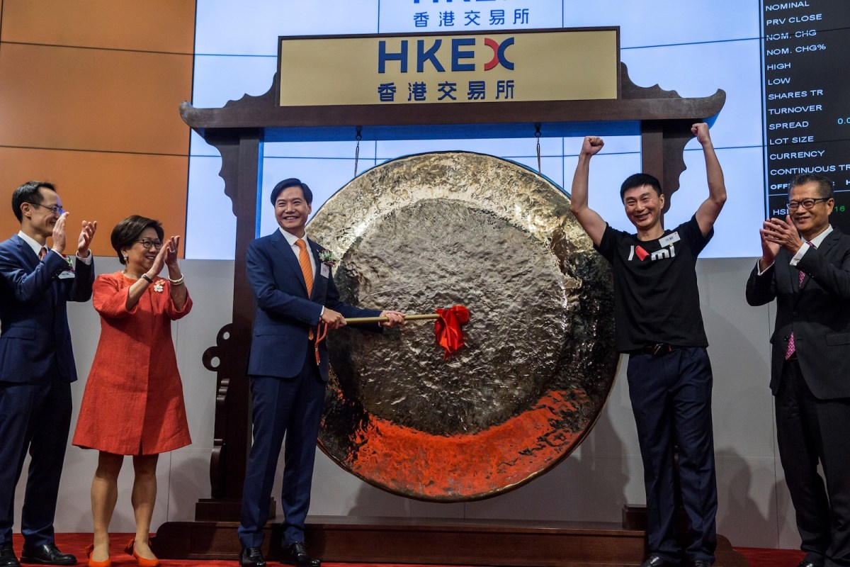 Xiaomi founder, chairman and CEO, Lei Jun, hits the gong at the company's IPO launch on the Hong Kong Stock Exchange. Photo: AFP/Isaac Lawrence