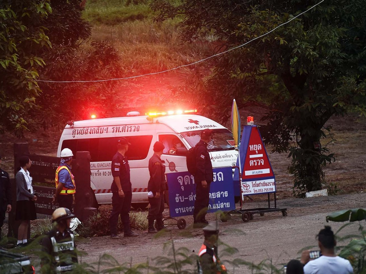 An ambulance leaves the Tham Luang cave area after divers evacuated some of the 12 boys trapped at the cave in Khun Nam Nang Non Forest Park in the Mae Sai district of Chiang Rai province on July 8, 2018. Photo: AFP/Lillian Suwanrumpha