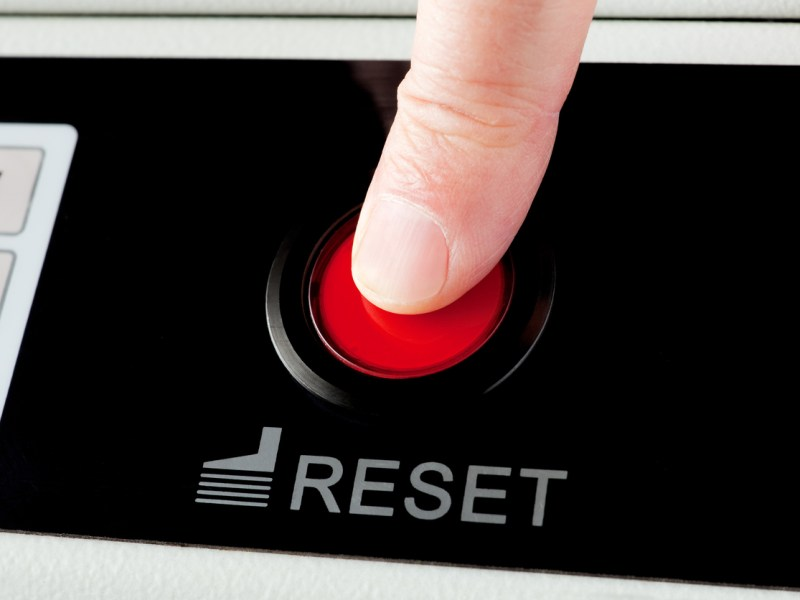 Closeup view of finger pressing a reset buttonRelated lightboxes: Photo: iStock