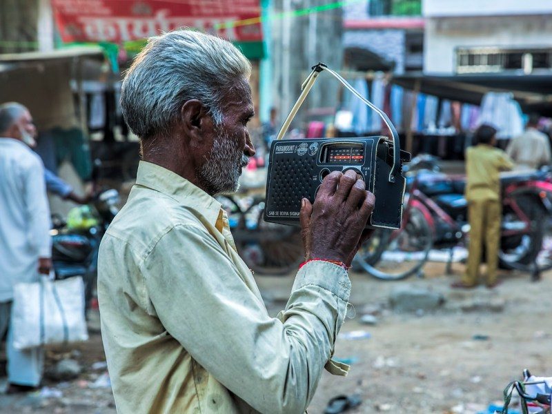 Indian man listening to radio. Photo: iStock