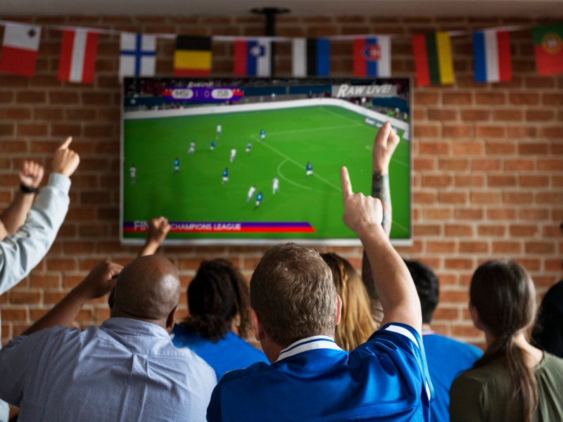 Friends cheer on their team while watching the World Cup. Photo: iStock