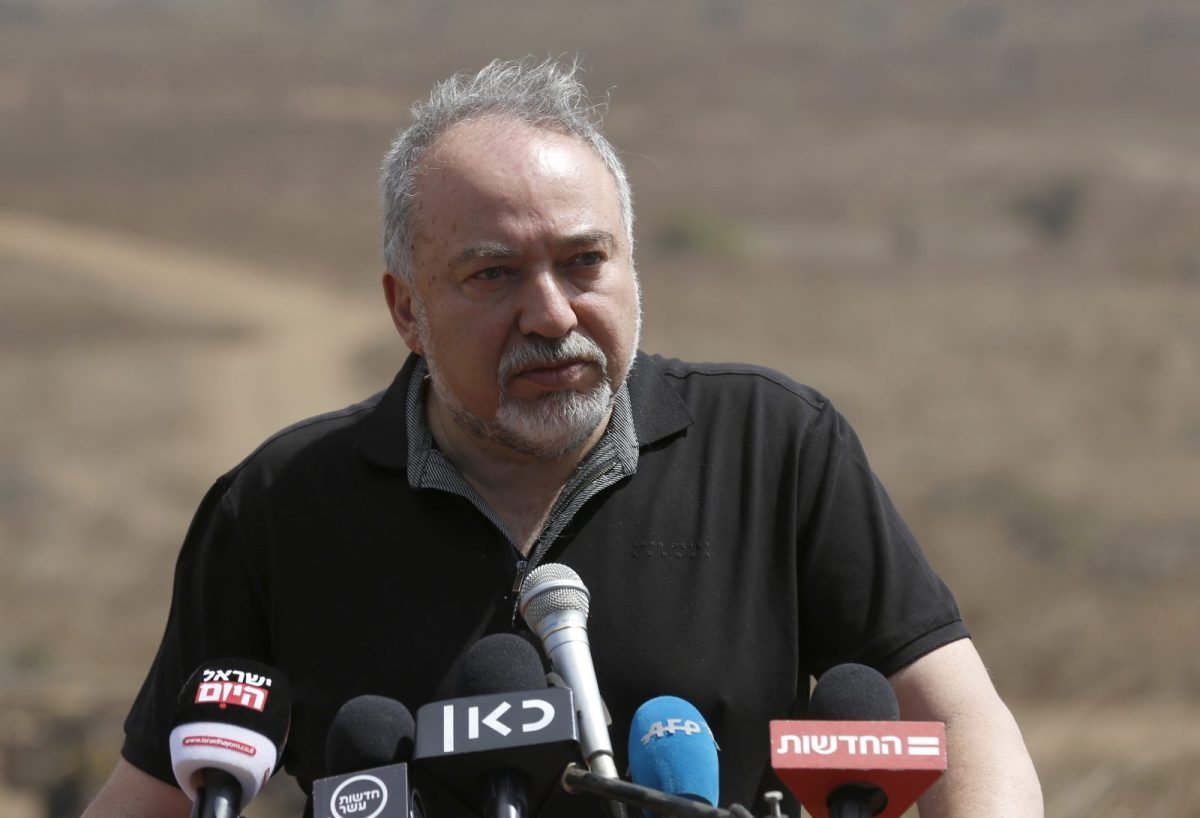 Israeli Defense Minister Avigdor Lieberman addresses the media during a visit to the Israel-Syria border. Photo: AFP / Jalaa Marey