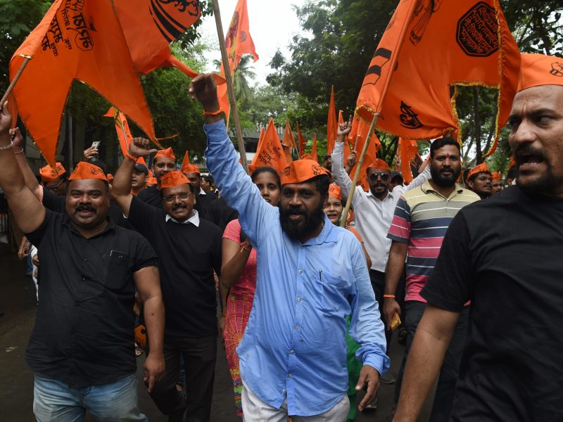 Indian members of the Maratha community in the state of Maharashtra shout slogans during a protest in Mumbai on August 9, 2018. AFP PHOTO / PUNIT PARANJPE