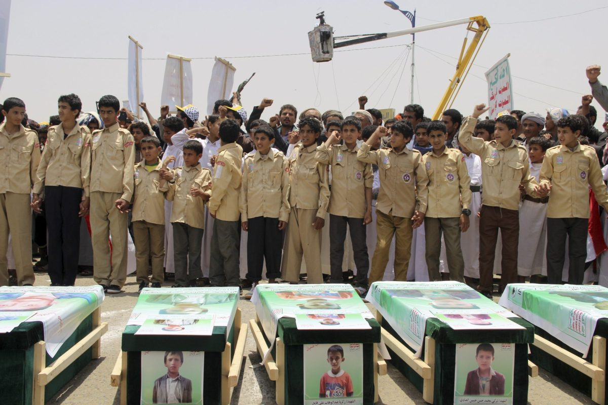 Yemeni children take part in a mass funeral for children killed in an air strike by the Saudi-led coalition last week. Photo:  AFP