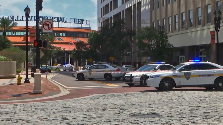 Police cars block a street in downtown Jacksonville, Florida, on August 26, after a mass shooting at a video game tournament. Photo: AFP via WJXT