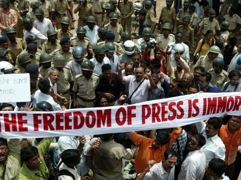 Indian media representatives march holding a banner in Ahmedabad against attacks on journalists in 2008. Photo: AFP / Sam Panthaky