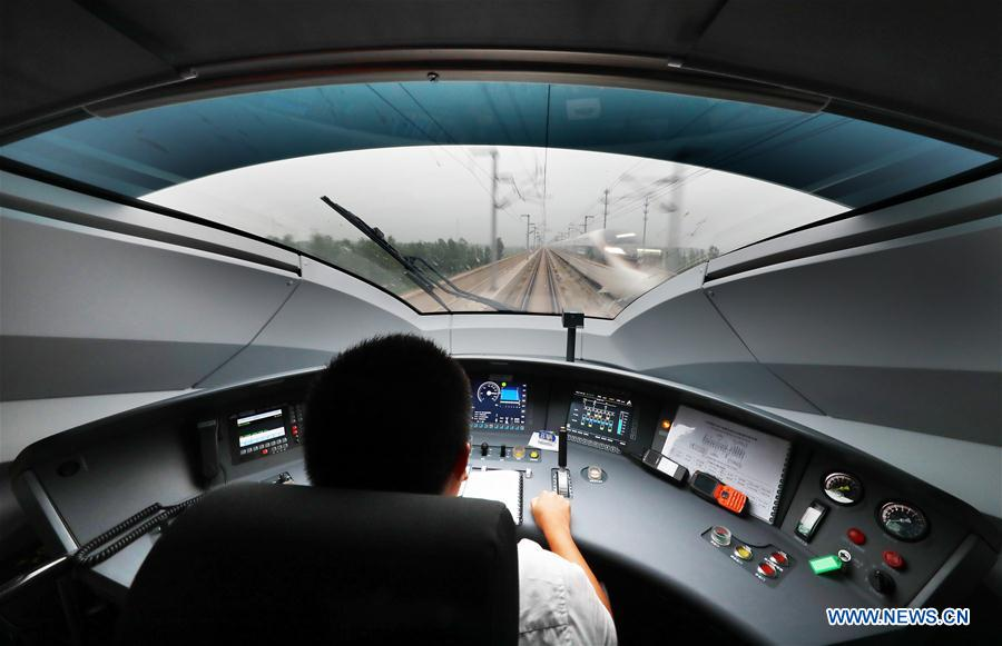 Inside the driver's cabin on a new Fuxing bullet train. Photo: Xinhua