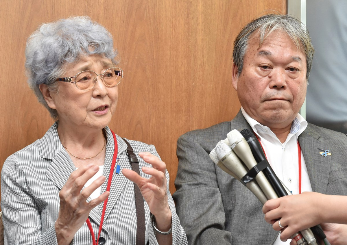 Sakie Yokota, left, the mother of Megumi Yokota - a girl abducted by North Korea in 1977, and Teruaki Masumoto speak to the media after meeting top officials in Tokyo in August 2017. Photo: AFP/ Yomiuri Shimbun