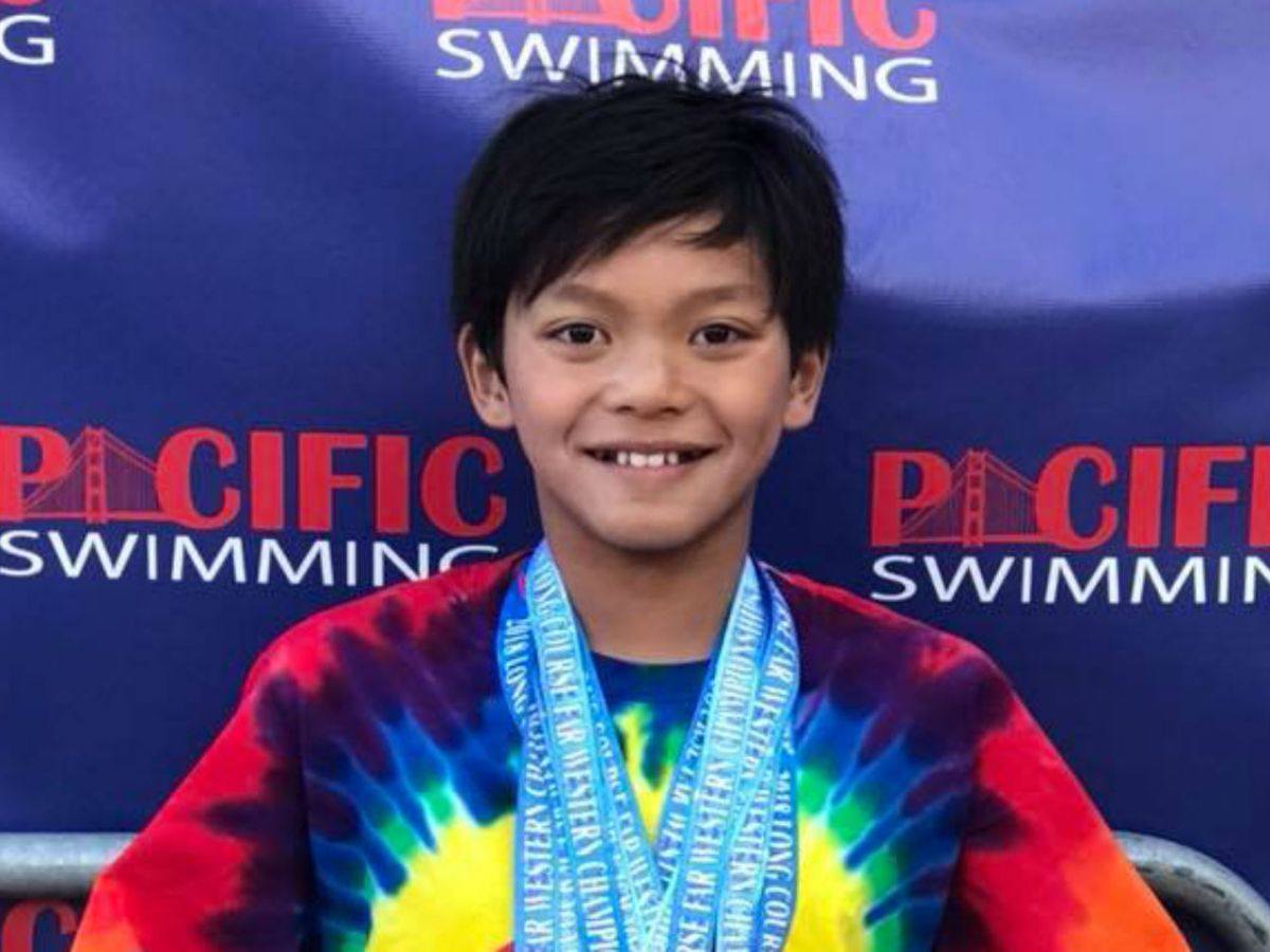 10-year-old Clark Kent Apuada has broken an old swim record that was set by Olympic swimmer Michael Phelps more than 20 years ago. Photo: Facebook