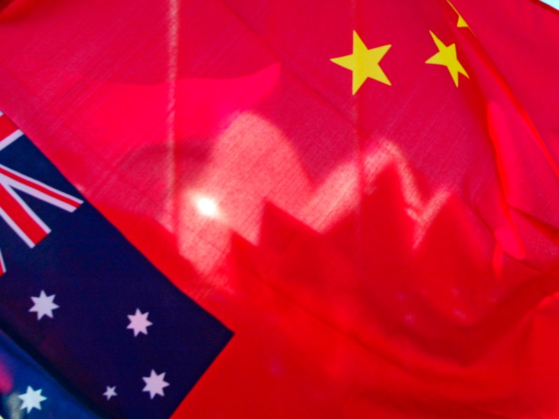 The shells of the Sydney Opera House are seen through a Chinese flag. Photo: AFP/Torsten Blackwood