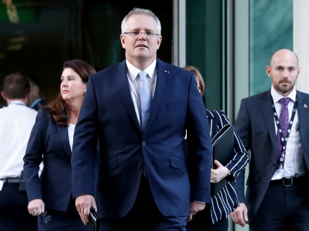 Australia's Treasurer Scott Morrison (C) was on August 24 picked as new prime minister after a Liberal Party coup in a stunning upset against key challenger Peter Dutton. / Photo: AFP/Pool/David Gray