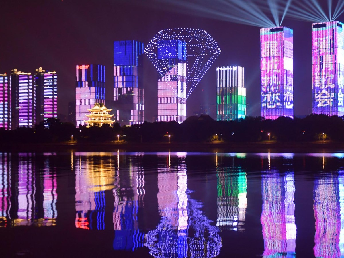 """777 drones form patterns and words that represent """"love"""" to light up the sky as part of Chinese Valentine's Day celebrations in Changsha city in Hunan province. Photo: AFP"""