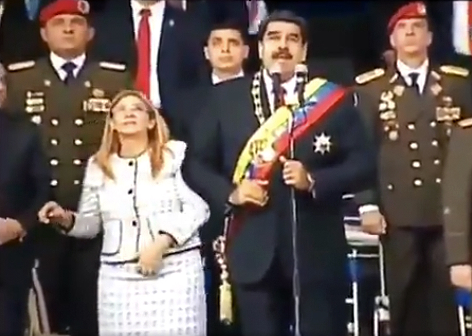 A screen grab from a video released by Venezuelan TV shows President Nicolas Maduro, his wife Cilia Flores and military leaders reacting to a loud bang during a ceremony to celebrate the National Guard in Caracas on August 4. Maduro was unharmed, but not everyone is convinced it was a bid to kill him. Photo: AFP / Venezuelan TV