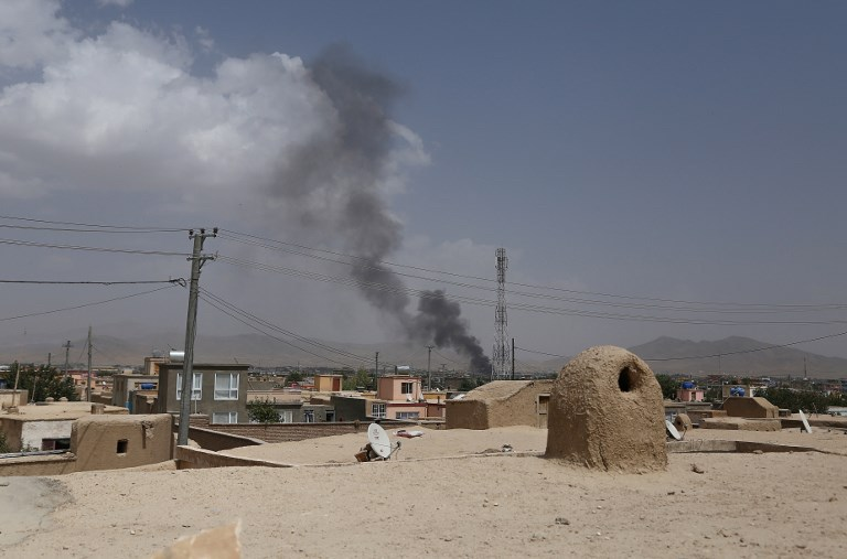 Smoke rises after Taliban militants launched an attack on the provincial capital of Ghazni on August 10, 2018. Photo: AFP/Zakeria Hashimi