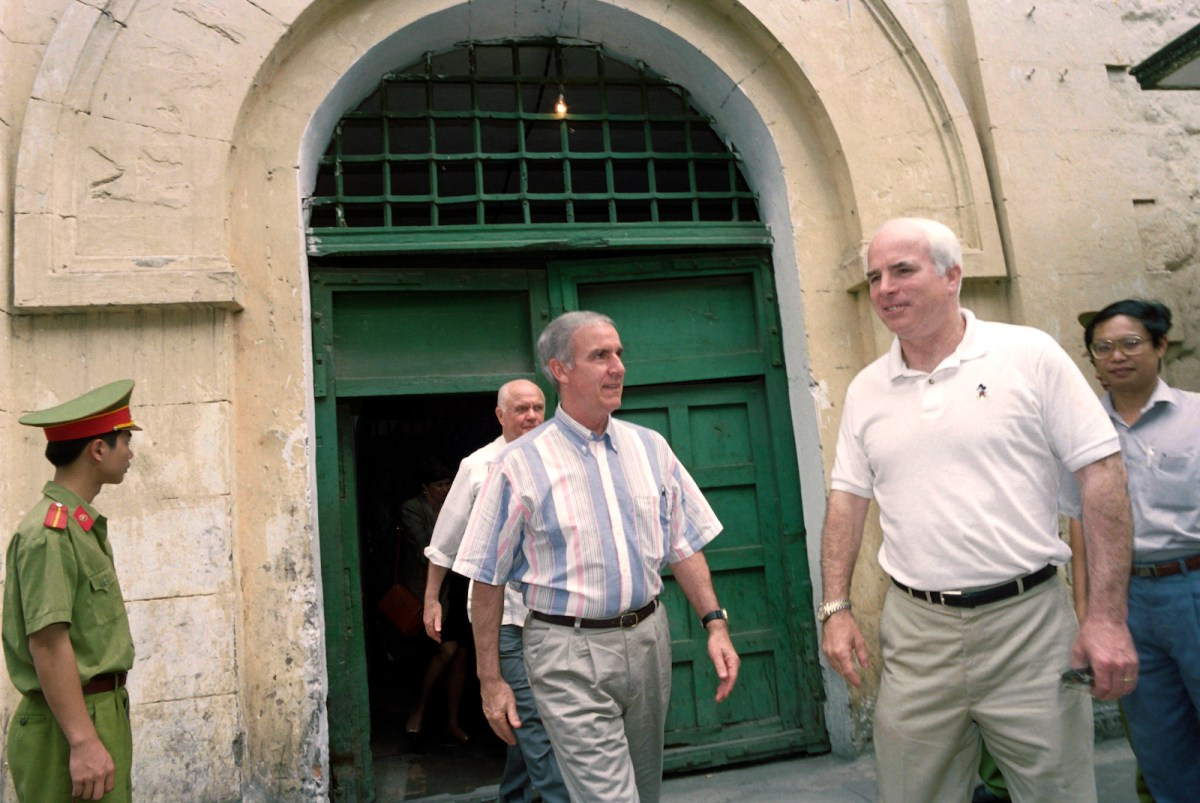 US Representative Pete Peterson (left) and US Senators John McCain (right) and John Glenn leaving Hanoi's central prison, nicknamed the Hanoi Hilton, in 1995. Photo: AFP/Hoang Dinh Nam