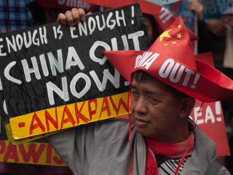 A protester holds a placard during a rally coinciding the Philippines' 120th Independence Day at the Chinese consulate in Manila, Philippines on Tuesday, 12 June 2018. Photo: AFP Forum/NurPhoto/ Richard James Mendoza