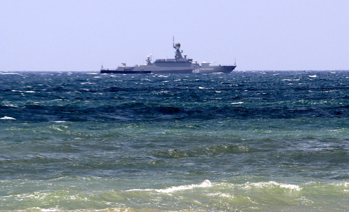 A Russian navy vessel is seen off the Syrian port of Tartus in late July. Photo: AFP / SANA