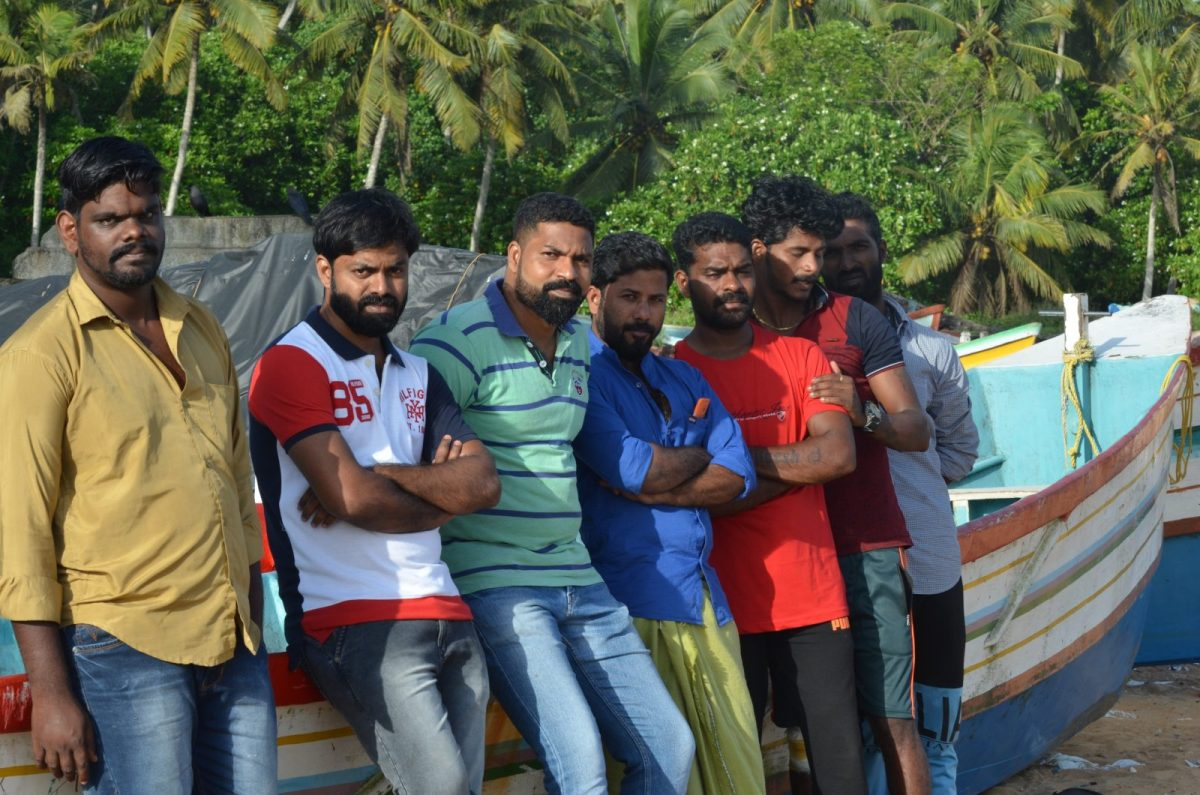 From left to right: Vipin Andrews, Johnny Chekkitta, Silvadasan Antony, John Mathew, Aneesh Pathrose, Rateesh Peter and Jineesh Jerome, stand aside their boat, which they used to save about 800 people stuck in the Kerala flood. Photo: Rejimon Kuttappan