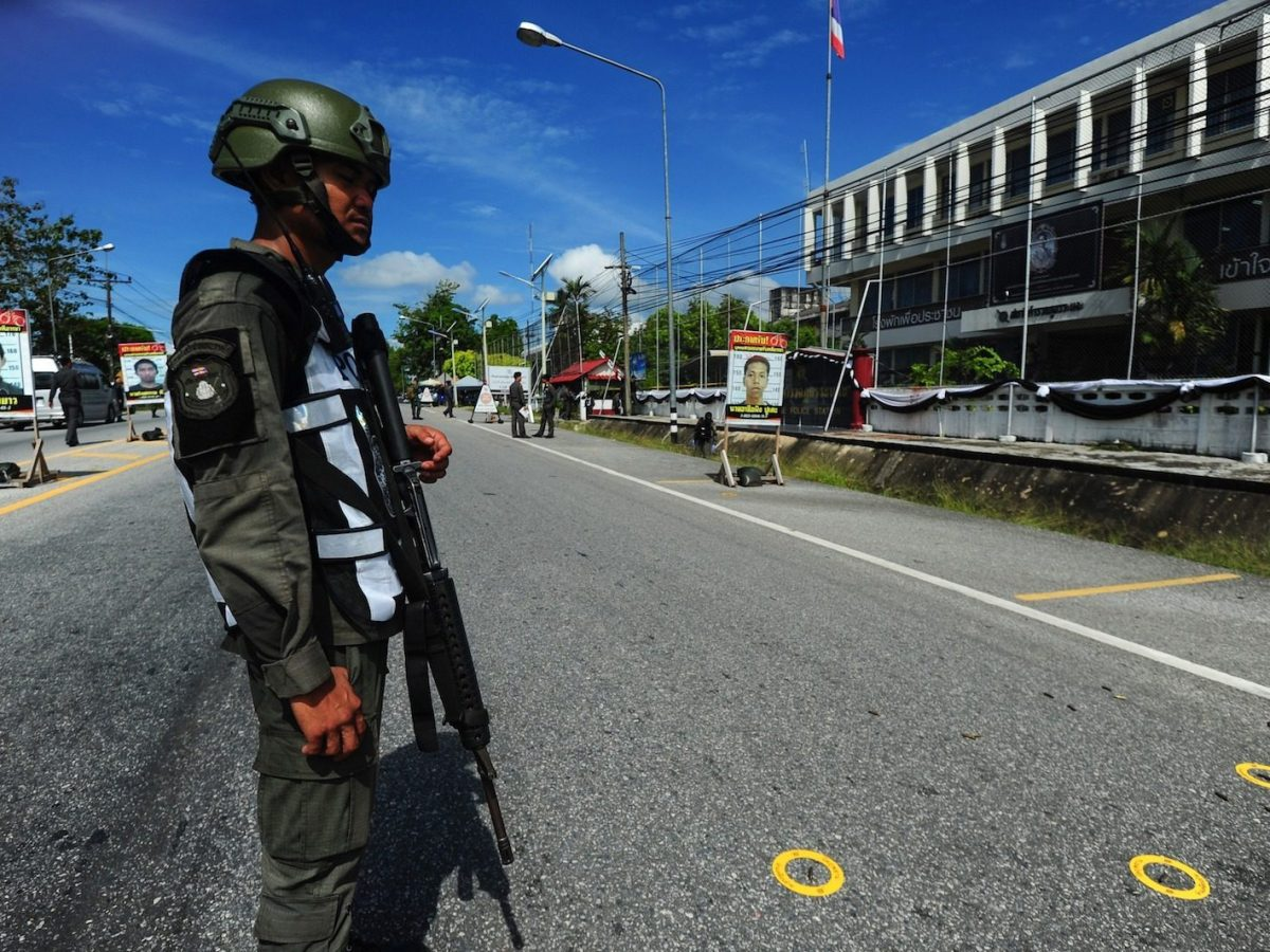 A Thai soldier stands watch over bullet markers in front of Rangae district's police station after a gun attack by suspected militants left one police officer dead and three wounded in the southern Thai province of Narathiwat, March 30, 2017. Photo: AFP/Madaree Tohlala