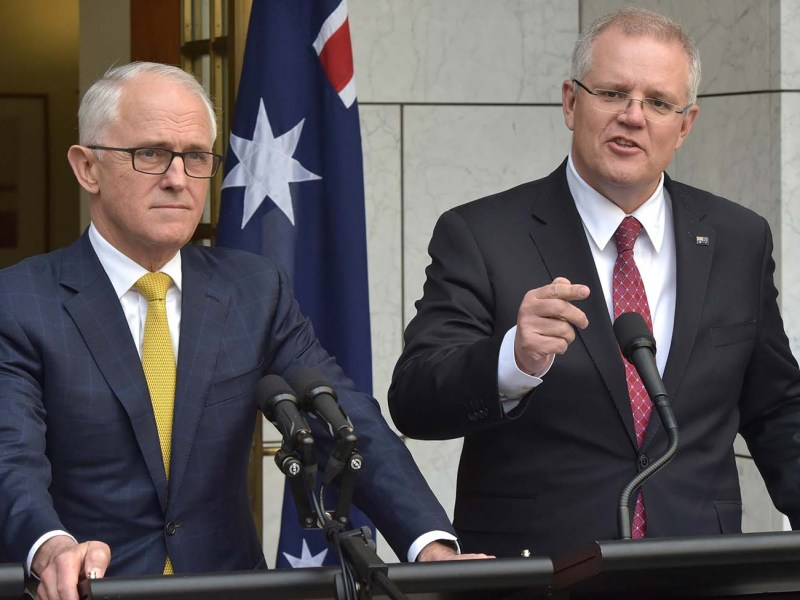 Australia's then Treasurer Scott Morrison (R) speaking beside Prime Minister Malcolm Turnbull on August 22, 2018 in Parliament House, Canberra. Photo: AFP / Mark Graham