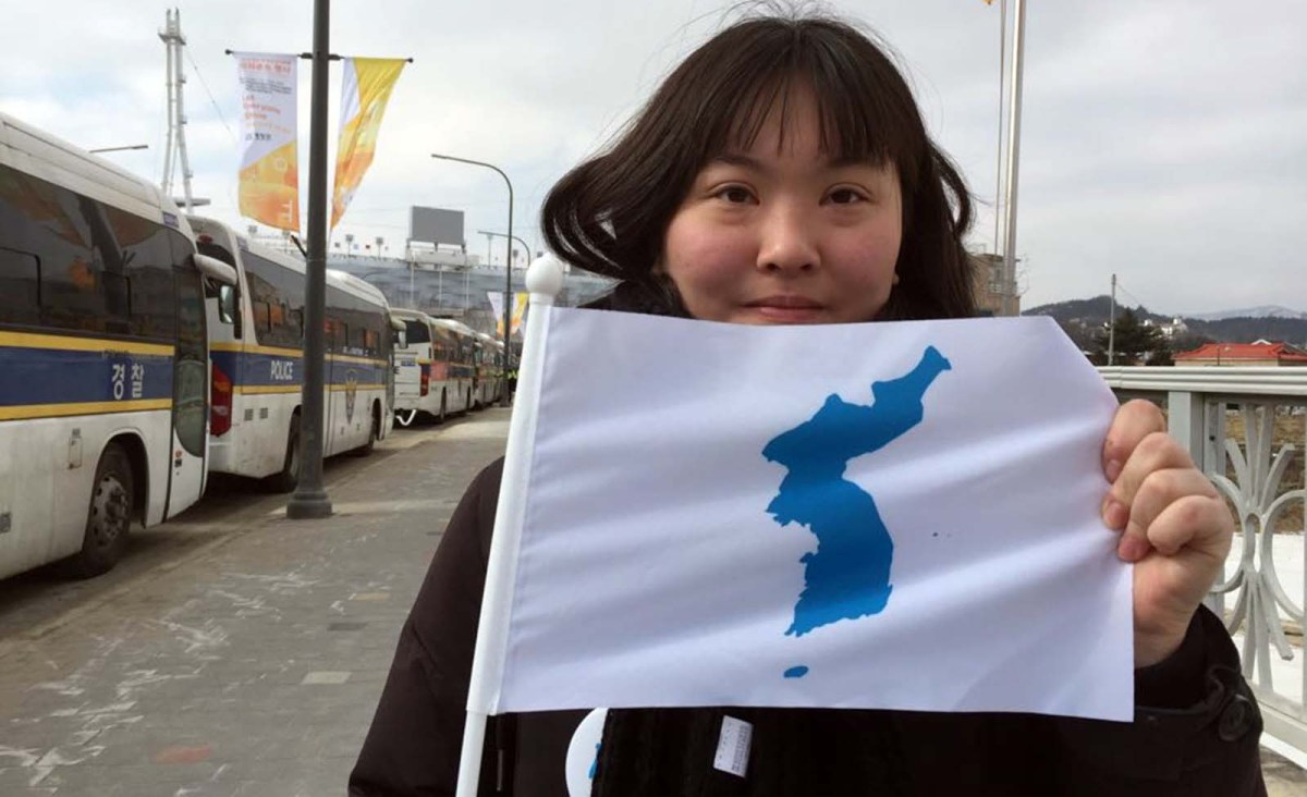 A flag depicting a combined Korea is proudly displayed during the 2018 Winter Olympics. Photo: Asia Times/Andrew Salmon