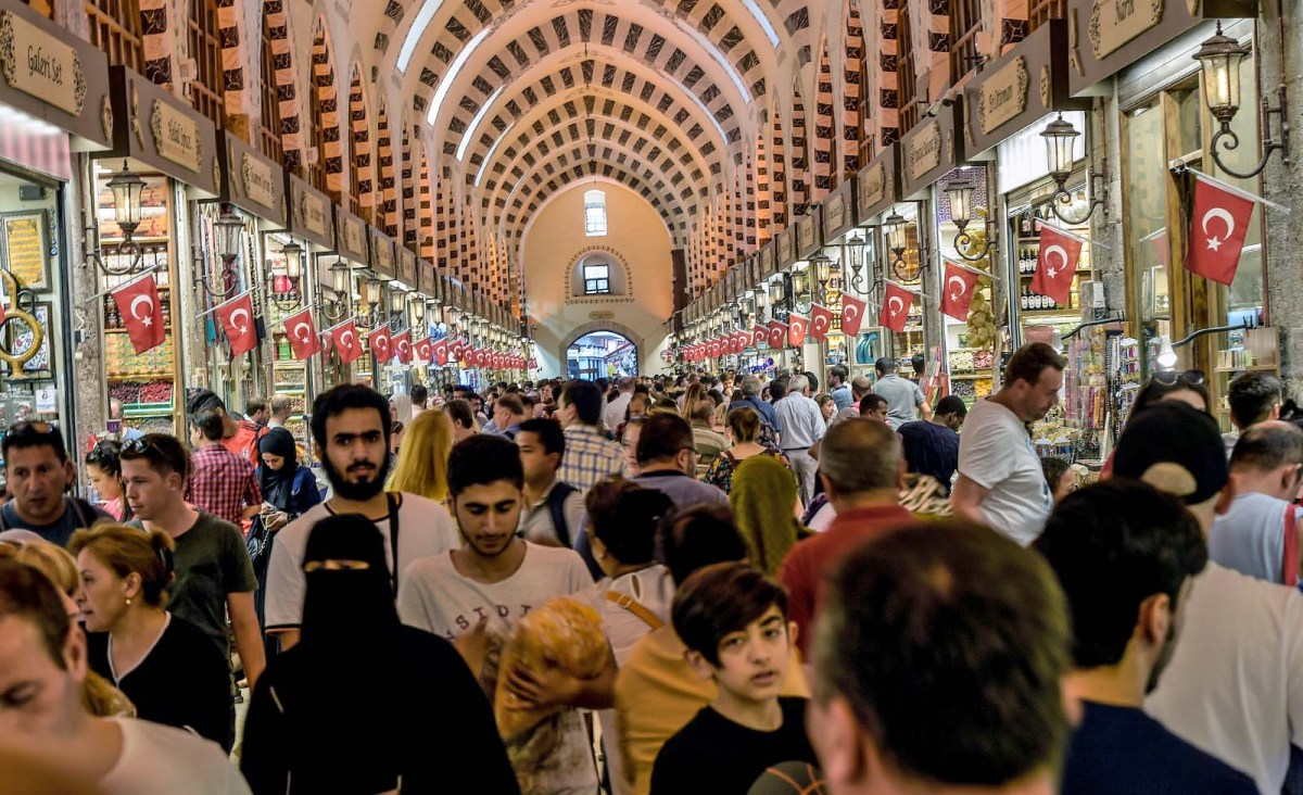 Shoppers walk through a historic bazaar in the central Sultanahmet district of Istanbul. Photo: AFP/ Yasin Akgul