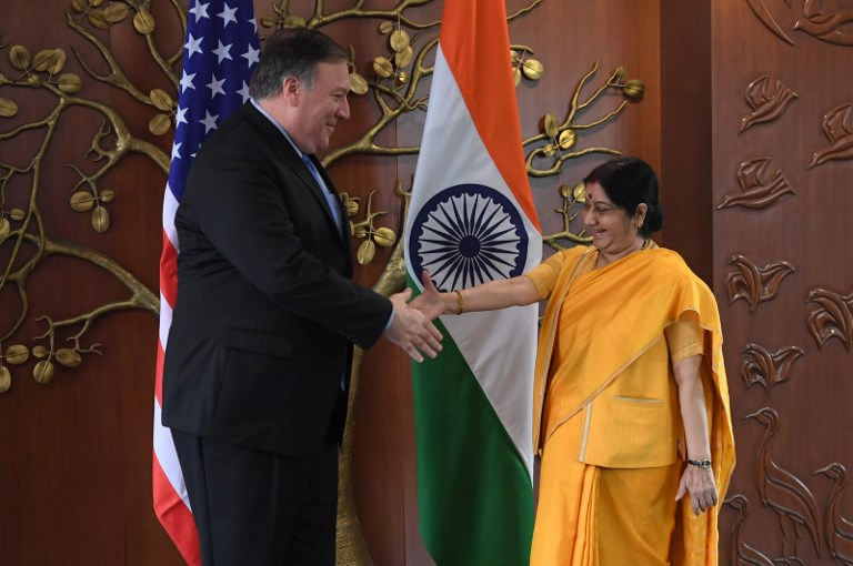 US Secretary of State Mike Pompeo shakes hands with Indian Foreign Minister Sushma Swaraj on September 6, 2018. Photo: AFP/Prakash Singh