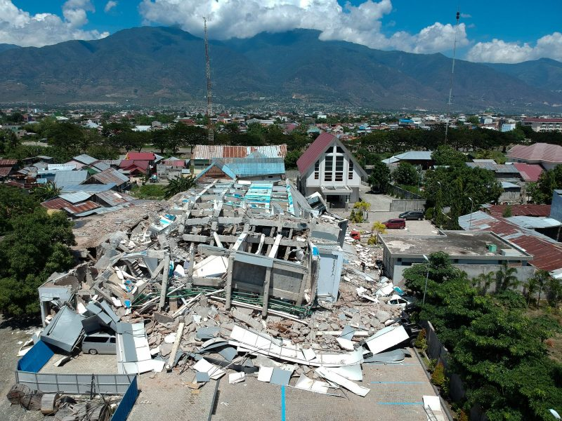This aerial picture shows the remains of a 10-storey hotel in Palu in Sulawesi after it collapsed following the strong earthquake and tsunami. Photo: AFP