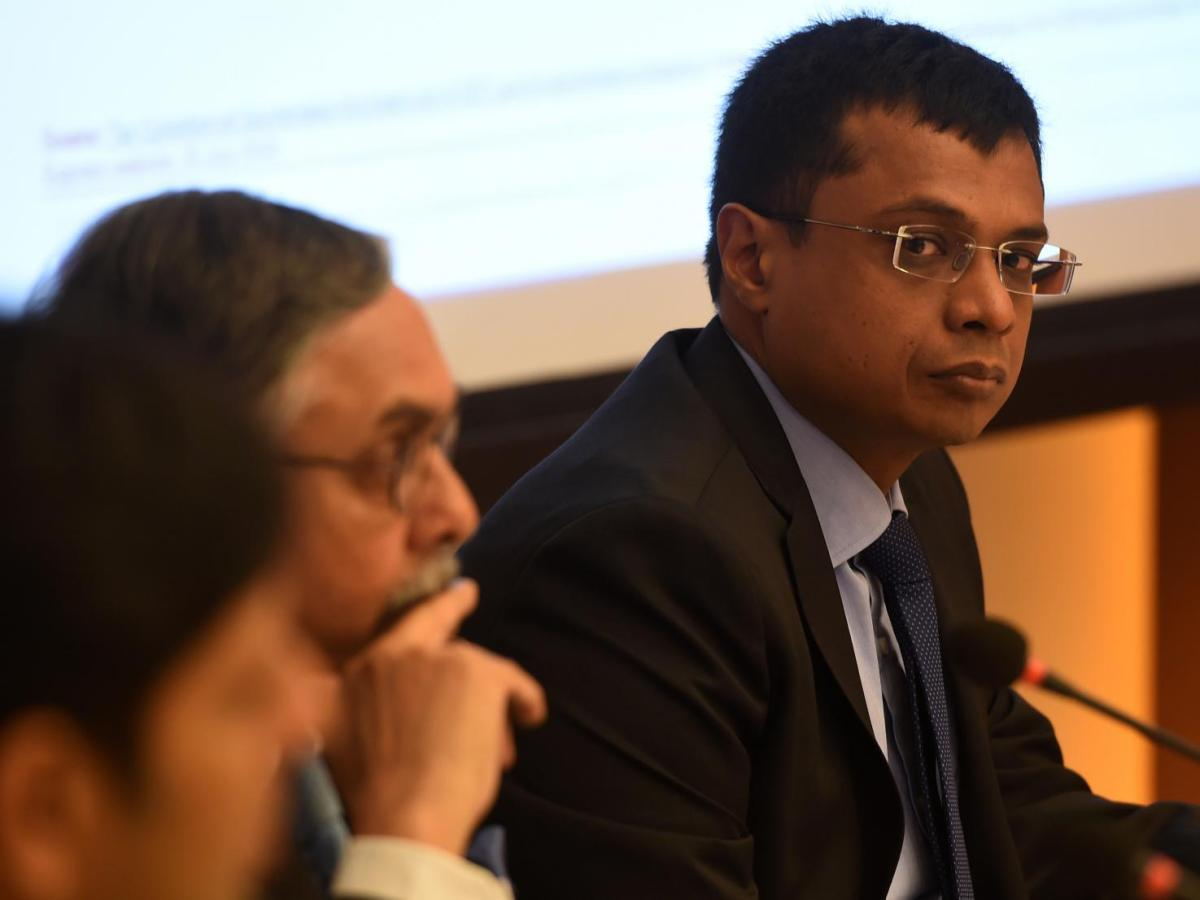 Sachin Bansal (R), a co-founder of Flipkart, during a press conference on the 'Model GST Law for the e-Commerce Sector' in New Delhi. Photo: AFP/Money Sharma