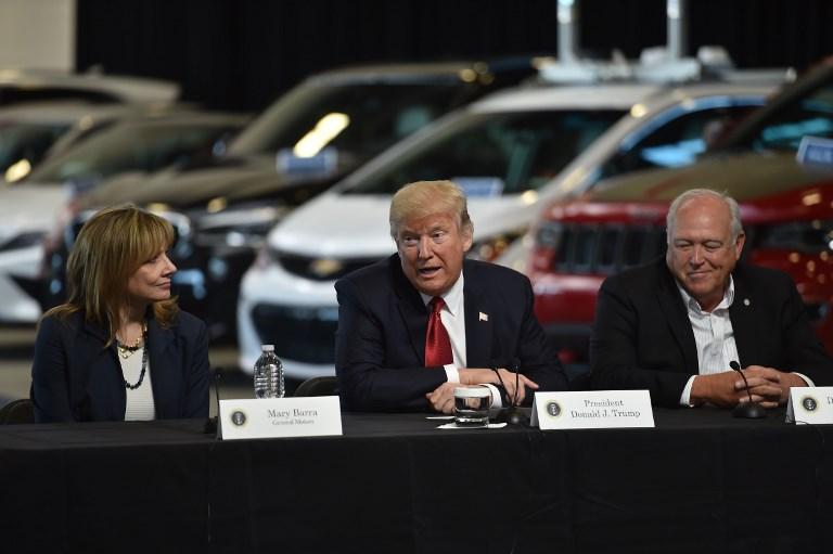 US President Donald Trump with General Motors CEO Mary Barra and United Auto Workers president Dennis Williams. Photo: AFP/Nicholas Kamm