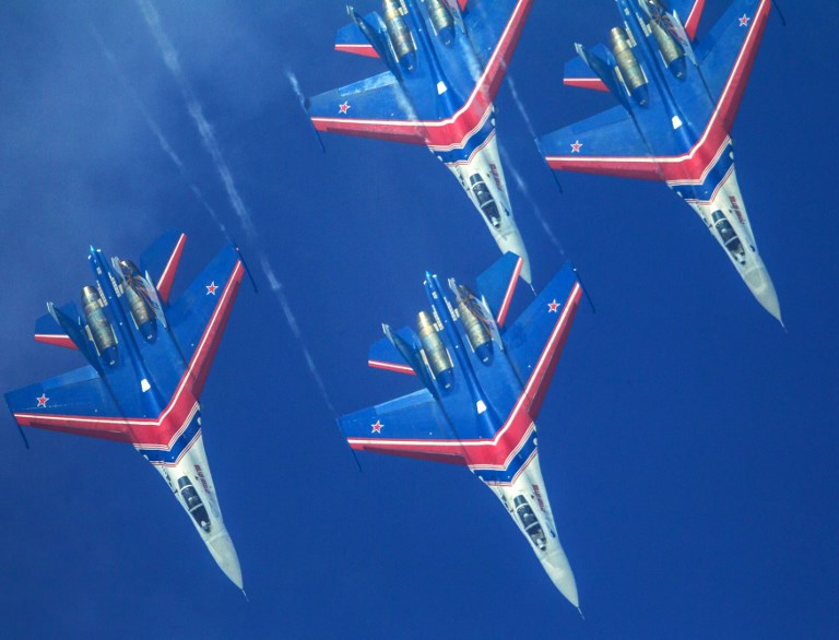 Sukhoi Su-27 fighter jets perform during an air show in Zhuhai City, China. Photo: AFP