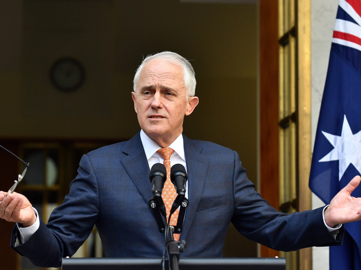 Australia's outgoing Prime Minister Malcolm Turnbull gestures at a press conference after a party meeting in Canberra on August 24, 2018. Scott Morrison was installed as Australia's seventh prime minister in 11 years on August 24 after a stunning Liberal party revolt instigated by hardline conservatives unseated moderate Malcolm Turnbull.  / AFP PHOTO / SAEED KHAN