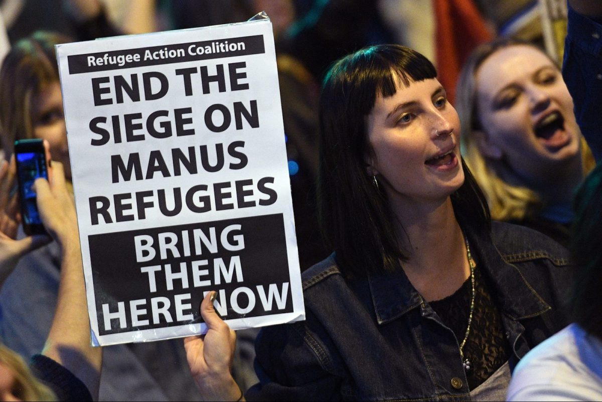 Protesters chant at a Liberal Party fundraiser in Sydney on November 10, 2017, as they call on the ruling Liberal coalition government to bring back 600 refugees from an Australian detention centre in Papua New Guinea. Photo: AFP/William West