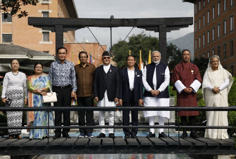 Frpm left: Myanmar First Lady Cho Cho, Nepal First Lady Radhika Shakya, Thai Prime Minister Prayut Chan-ocha, Sri Lankan President Maithripala Sirisena, Nepalese Prime Minister Khadga Prasad Sharma Oli, Myanmar President Win Myint, Indian Prime Minister Narendra Modi, Bhutanese Chief Justice Dasho Tshering Wangchuk, and Bangladeshi Prime Minister Sheikh Hasina pose for a group photo during the Bay of Bengal Initiative for Multi-Sectoral Technical and Economic Cooperation (BIMSTEC) summit in Kathmandu on  August 31, 2018. Photo: / AFP / Pool / Navesh Chitrakar