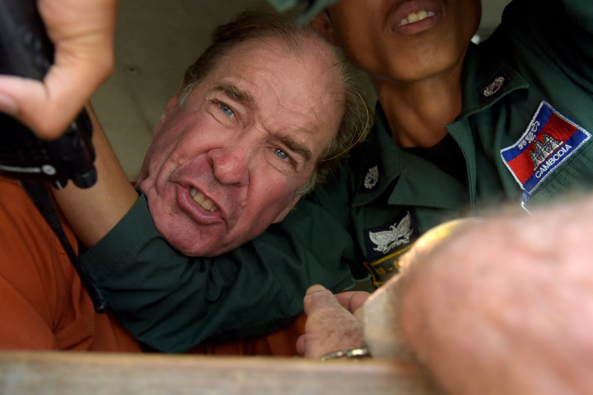 Australian filmmaker James Ricketson reacts as he attempts to speak to journalists from a prison vehicle after his verdict at the Phnom Penh court on August 31, 2018. Photo: AFP/Tang Chhin Sothy