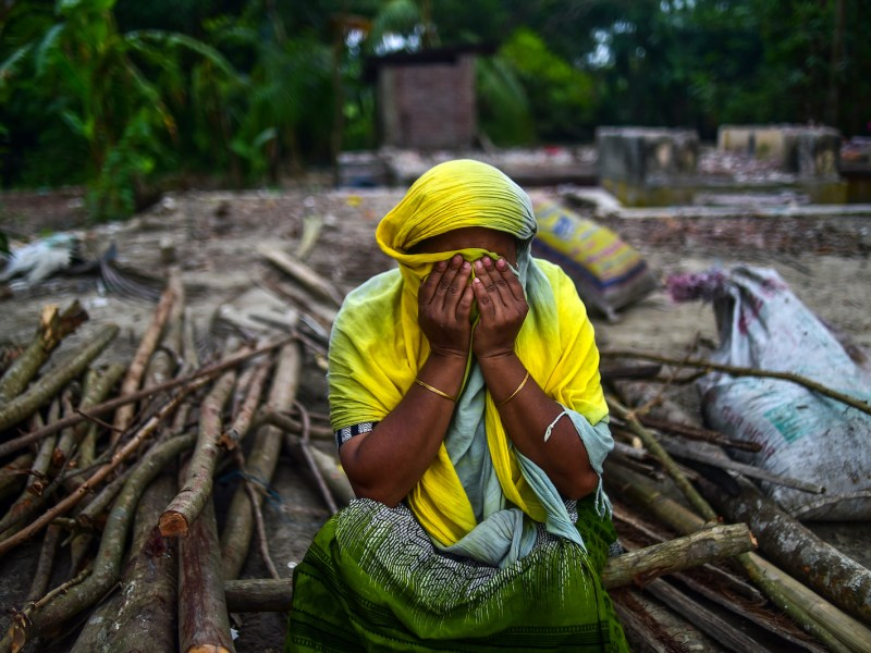 A Bangladeshi woman weeps in anguish beside her house, which was washed away from the banks of the Padma River at Shariatpur, 40km south of Dhaka on September 13, 2018, by aggressive erosion of land.  Photo: AFP / Munir Uz Zaman