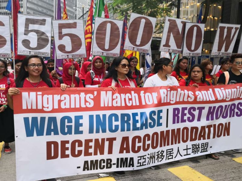 Domestic workers in Hong Kong march to government headquarters on Hong Kong Island. Photo: Facebook/AMCB