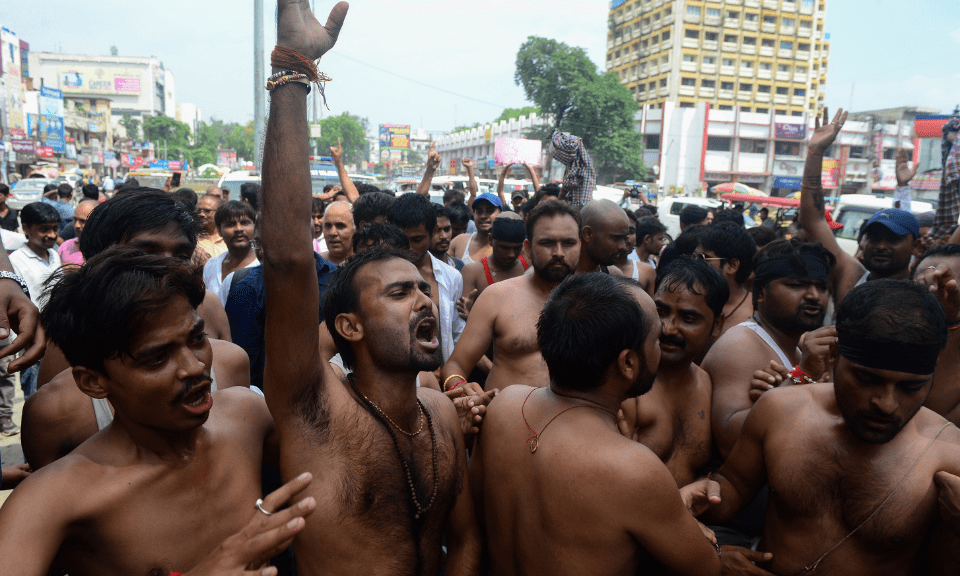 Members of the upper-caste and Other Backward Class groups take part in a strike over a legislative amendment to the Scheduled Castes and Scheduled Tribes Act in Allahabad on Sept. 6, 2018. Photo: AFP