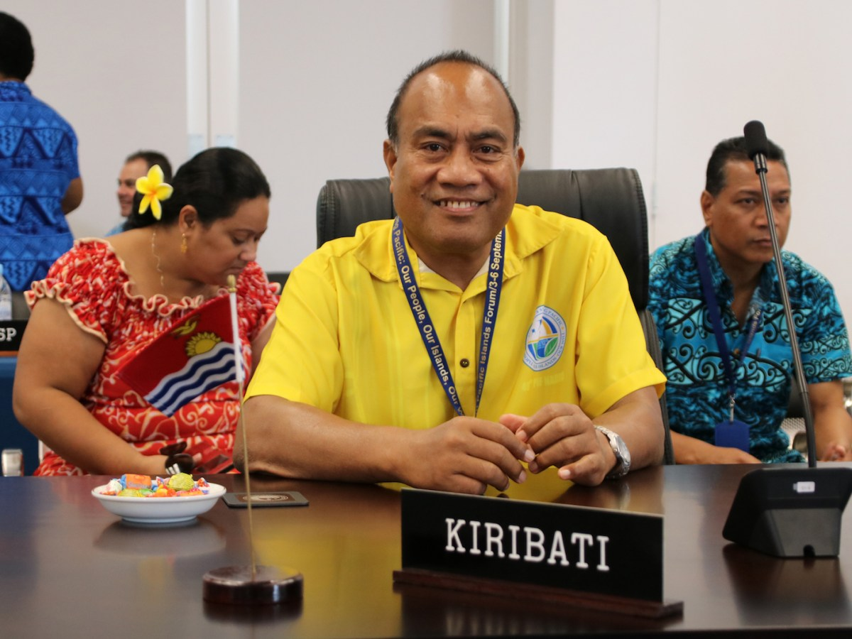 Kiribati President Taneti Mamau, center, smiles at a meeting ahead of the 18-nation Pacific Islands Forum, which started on Sept 3. Talks center on the threat climate change poses to island states and China's rising influence in the region. Photo: AFP / Mike Leyral