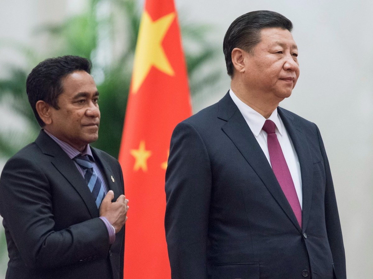 (FILES) In this file photo taken on December 7, 2017 Maldives' President Abdulla Yameen (L) and China's President Xi Jinping listen to their national anthems during a welcome ceremony at the Great Hall of the People in Beijing.Back when he was a mild-mannered civil servant, few in the Maldives predicted Abdulla Yameen would one day run the country, let alone with an iron grip, locking up judges, his rivals and even his 80-year-old half-brother. / AFP PHOTO / Fred DUFOUR