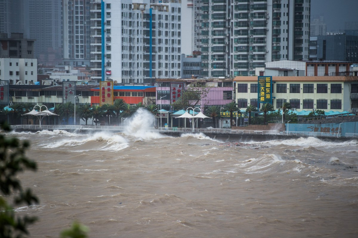 Monster waves surge over a sea wall in Shenzhen in Guangdong province. Cities built close to the water are likely to face increasing problems due to rising sea levels and more severe storms due to global warming. Photo: AFP