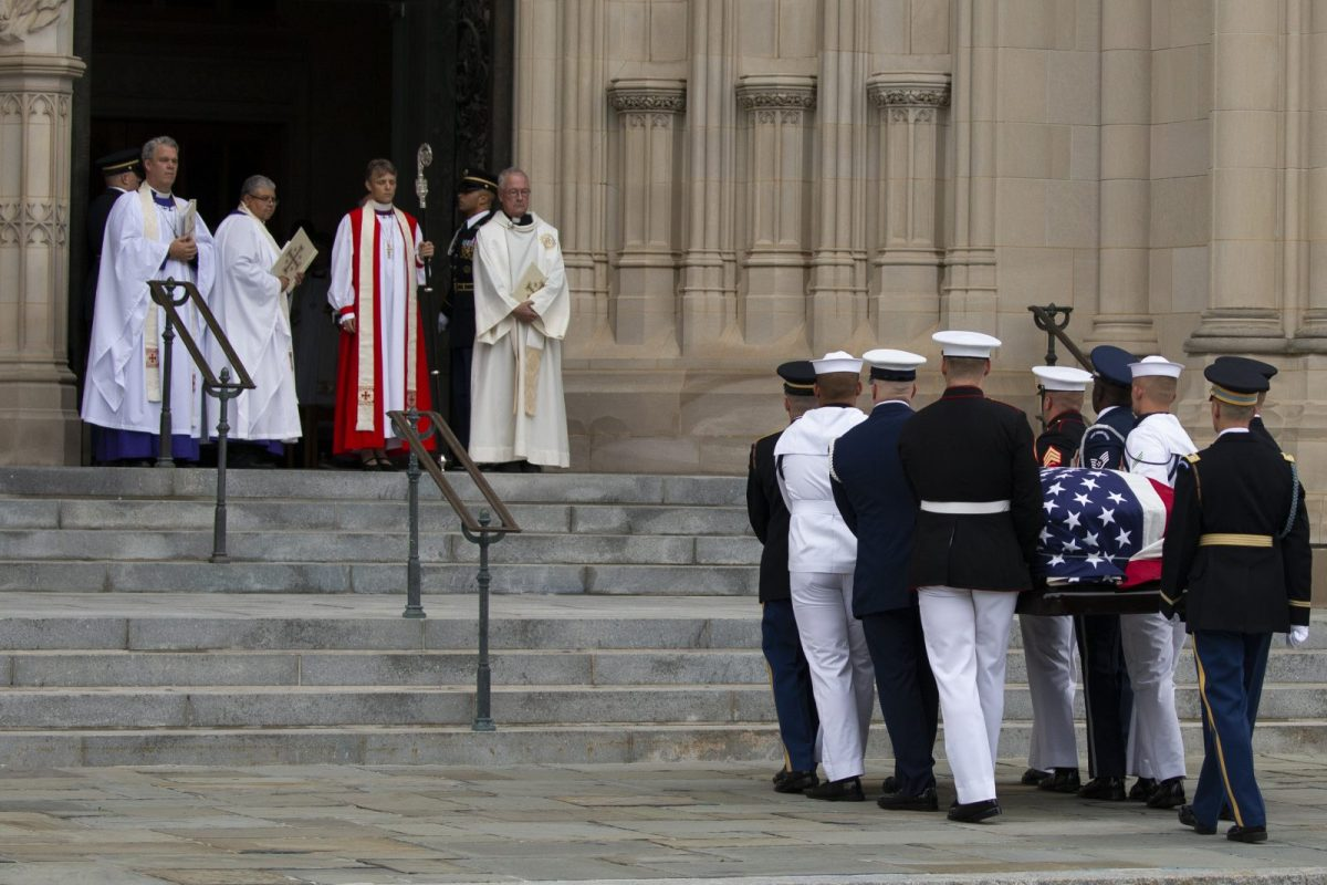 A Military Honor Guard carries the casket of Senator John McCain into the Washington National Cathedral on September 1, 2018. Photo: AFP/Alex Edelman/CNP