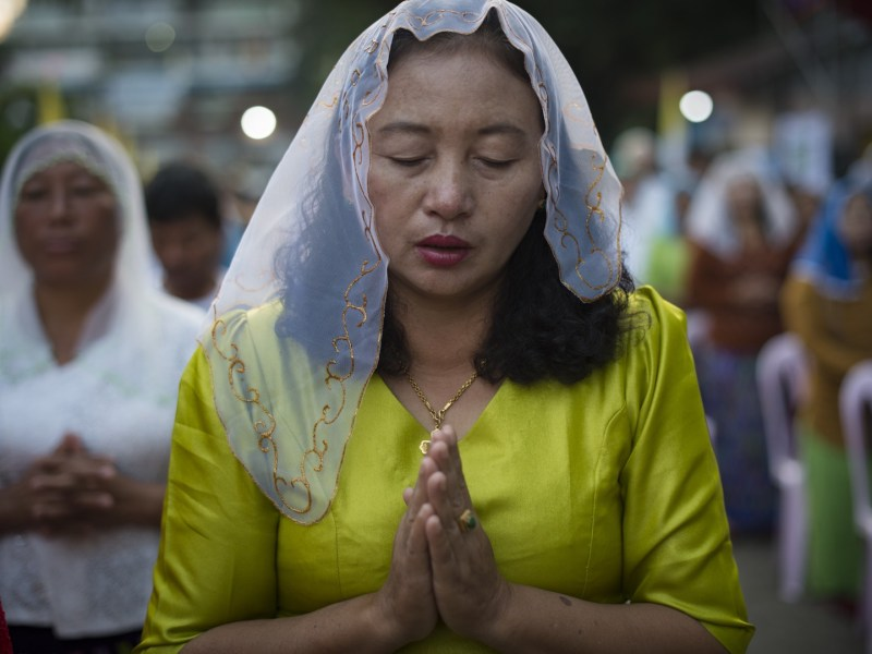 A Myanmar Christian woman takes part in morning prayers in Yangon on November 28, 2017. Photo: AFP/Lillian Suwanrumpha