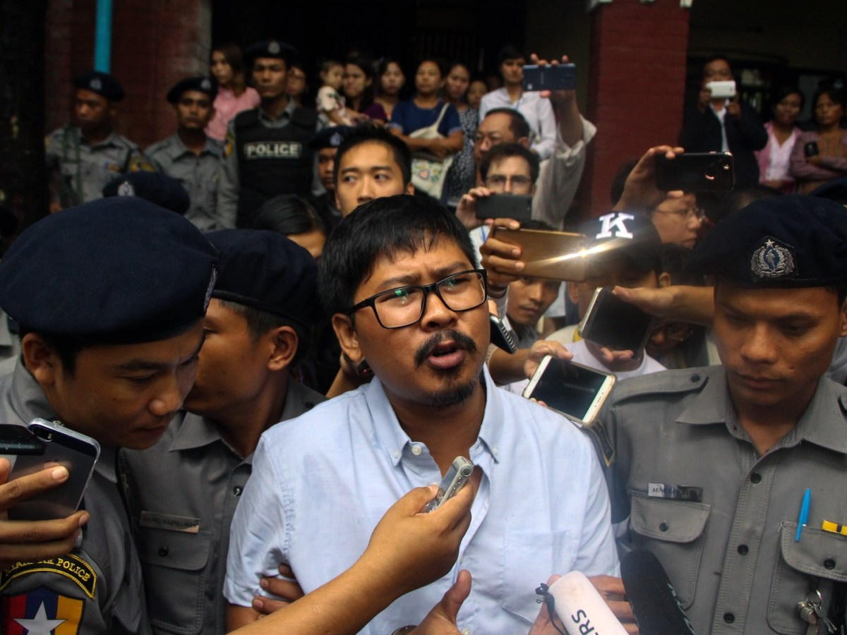 Journalist Wa Lone speaks to reporters as he is escorted from a courthouse in Yangon on July 9. He and colleague Kyaw Soe Oo were sentenced to seven years in jail after their conviction. Photo: AFP / Myo Kyaw Soe