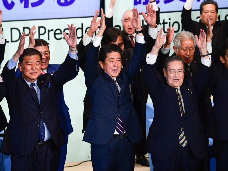 Japan's Prime Minister Shinzo Abe (C) celebrates after winning re-election as leader of the ruling Liberal Democratic Party in Tokyo on September 20, 2018. Photo: AFP