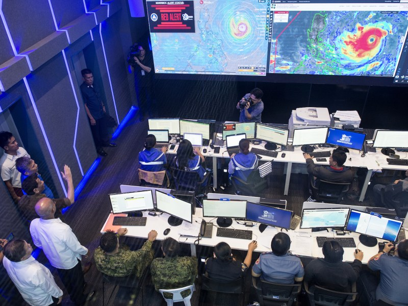 President Rodrigo Duterte (fourth left, arm upraised) gestures while visiting the National Disaster Risk Reduction and Management Council Operations Center in Manila on Sept. 13, 2018, as Typhoon Mangkhut barrels toward the Philippines. Photo: AFP / Noel Celis