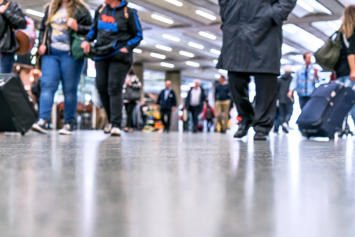 Defocused People Walking in modern hallway Photo: iStock