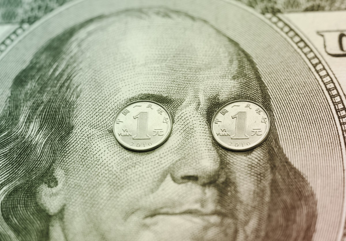 Cashed in: yuan coins are placed over the eyes of Franclin on a 100 dollar banknote. Photo: iStock
